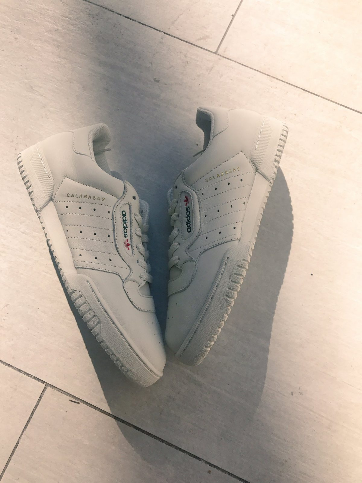 After months of speculation and long distance paparazzi shots we finally get a detailed look at the Yeezy X Adidas Powerphase Calabasas