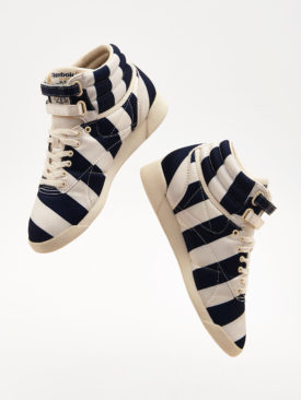 e5d9be766e4 The collection is completed by statement Reebok Freestyle Hi trainers in  navy and cream satin spots or stripes. ASOS White